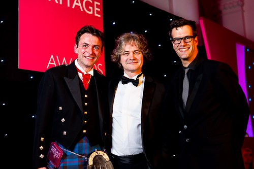 Thomas Elliott and Director of Heritage Chris Henry with awards host Marcus Brigstocke
